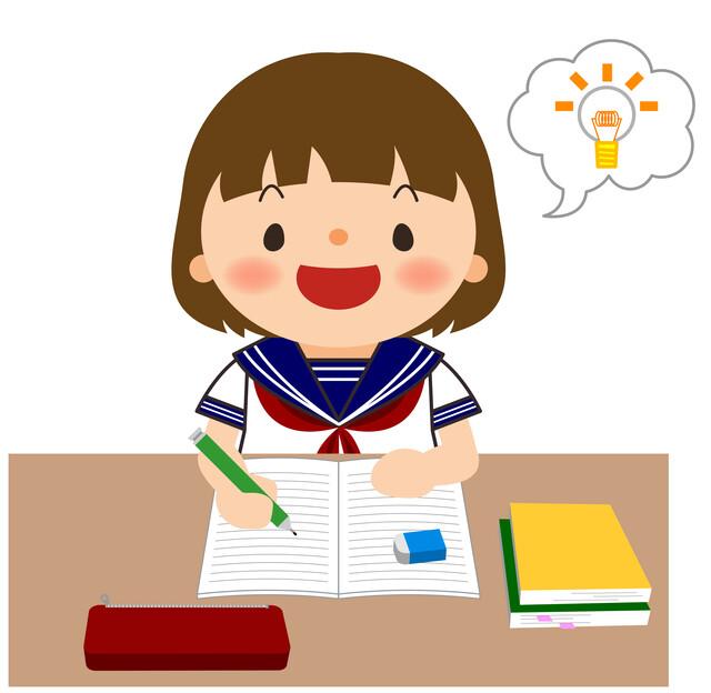 参考書を使って勉強する中学生